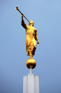 Golden Angel Moroni blowing a trumpet. This is usually seen on top of a Mormon Temple