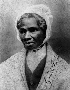 Picture of Sojourner Truth. She is a dark-skinned black women wearing a white bonnet with a high collared white shirt and shawl wrapped around her.